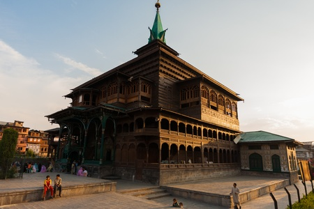 shah: SRINAGAR, INDIA - JULY 11, 2009: Local people congregate after evening prayers outside of Shah E Hamdan, a wooden mosque and major tourist attraction, in Kashmir on July 11, 2009 in Srinagar, India