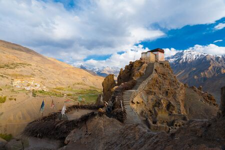 valley below: A wide view of the watchtower at the old monastery and its commanding view of the new monastery, mountains and Spiti valley below in Dhankar, Himachal Pradesh, India