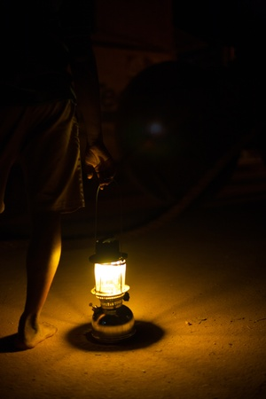 undeveloped: A lone lantern illuminates a dirt road in Gokarna India
