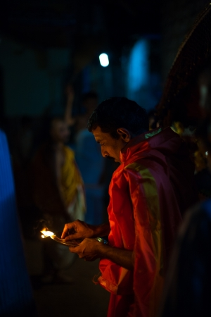 palanquin: GOKARNA, INDIA - MARCH 26, 2009: Unidentified Indian brahmin blesses a residence by burning incense at night during a monthly full moon hindu ceremony on March 26, 2009 in Gokarna, India
