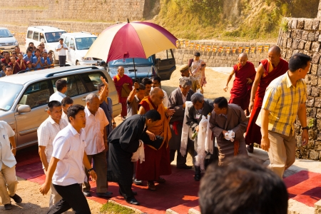 phalanx: DHARAMSALA, INDIA - JUNE 25, 2009: A phalanx of men surround his Holiness, the Dalai Lama on his way to a speech, on June 25, 2009 in Dharamsala, India Editorial