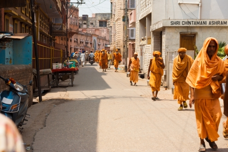 pilgrims: HARIDWAR, INDIA - MAY 21, 2009: Unidentified religious men walk down a street during a pilgrimage to the holy city of Haridwar on May 21, 2009 in Hardiwar, India Editorial