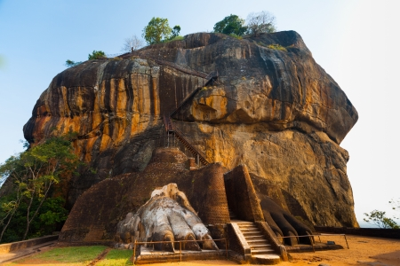 The second level stairs and entrance to the former fortress and monastery of Sigiriya rock, guarded by a pair of lion feet in Sri Lanka