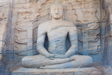 monolithic: The front of a monolithic sitting Buddha, Gal Viharaya, carved from a unique striated granite rock at Polonnaruwa, the ancient kingdom capitol of Sri Lanka