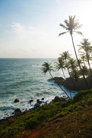 headland: A beautiful high key tropical landscape of the ocean and rocky coastline from  a headland near the beach resort village of Mirissa, Sri Lanka Stock Photo