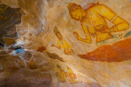The ancient hand painted cave frescoes of women inside Sigiriya rock, a former fortress and monastery in Sri Lanka. Horizontal