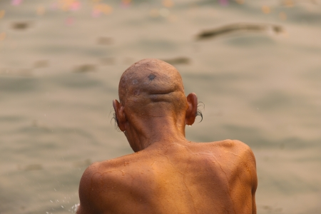 ganges: VARANASI, INDIA - FEBRUARY 1, 2008: An unidentified Indian man with long ear hair bathes in the Ganges on February 1, 2008 in Varanasi, India. Long ear hair problem effects 74% of the population Editorial