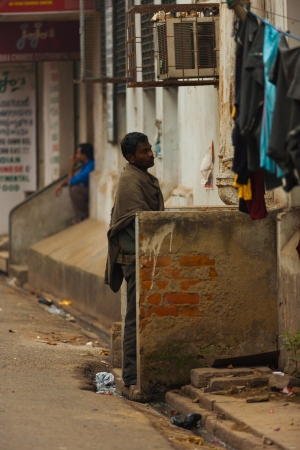 KOLKATA, INDIA - FEBRUARY 2, 2008: An unidentified Indian man uses a public street urinal on February 2, 2008. Women are now demanding equal public access to toilets for hygiene and safety reasons