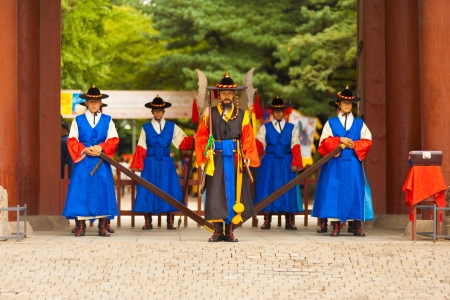 SEOUL, KOREA - AUGUST 27, 2009: Armed guards in traditional costume stand at the entry gate of Deoksugung Palace, a tourist landmark, in Seoul, South Korea on August 27, 2009