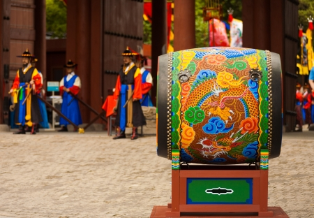 SEOUL, KOREA - AUGUST 27, 2009: A traditional Korean drum rests at the entrance to Deoksugung Palace, a tourist landmark, for changing of the guards ceremony in Seoul, South Korea on August 27, 2009