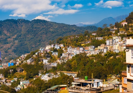 Landscape of the buidlings set on the sloping hillside of Gangtok in Sikkim, India