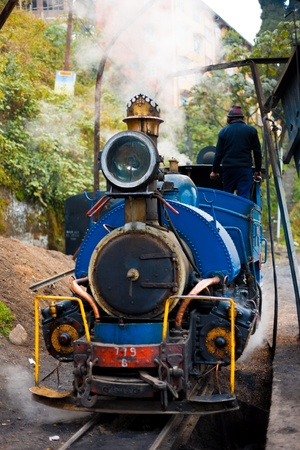 darjeeling: Steam escapes the smokestack in this front view of the engine of the tourist attraction steam toy train in Darjeeling, India Stock Photo