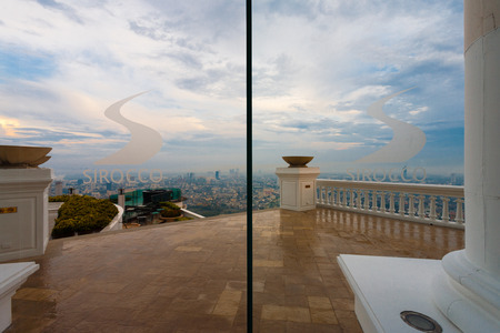 BANGKOK, THAILAND - APRIL 29, 2007: A wet patio of the skybar at Sirocco Restaurant, a tourist attraction made famous in the movie, Hangover part 2, overlooks the downtown skyline at the Lebua Hotel