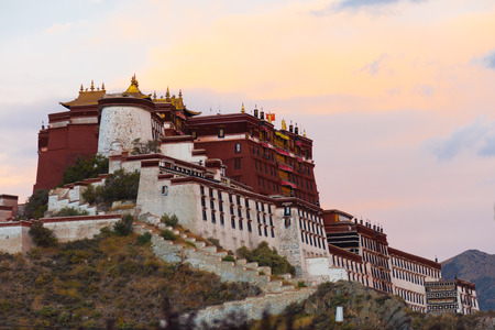 Darkness approaches at the gloomy evening Potala Palace as the sunset fades in the sky in Lhasa, Tibet, China