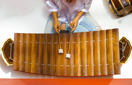 played: A traditional wooden Thai musical instrument, ranat ek, resembling a xylophone is played with mallets seen from directly above