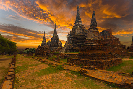 A beautiful sunset behind the Wat Phra Si Sanphet temple at the ancient ruins of the former Thai capitol in Ayutthaya, Thailand photo