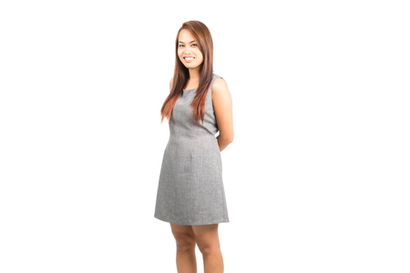 approachable: Profile of good looking, stunning, charming Asian girl in gray sleeveless dress with light brown hair smiling positively with genuine, real and approachable nature.