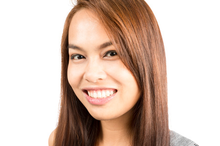 approachable: Headshot portrait of good looking, gorgeous, charming Asian girl with light brown hair smiling positively showing genuine, real friendly and approachable nature.