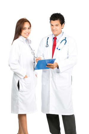 male and female: A diverse male, female team of doctors standing side by side smiling, looking at camera showing warm, compassionate, empathetic expressions. Vertical