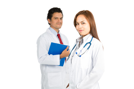 warmly: A beautiful confident Asian female, hispanic male doctors team smiling warmly showing compassion, caring, kindness and empathy. Focus on foreground H