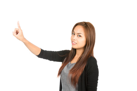 arm extended: Side profile of stunning Asian woman in black sweater with light brown hair, arm extended index finger pushing imaginary button looking at camera. Thai national Chinese origin. Half length horizontal