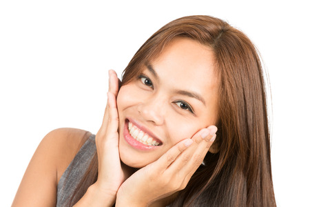 approachable: Portrait of adorable, approachable, beaming Asian girl in sleeveless shirt, hands cupping face smiling, expressing friendly, cute, charming, positive, girly attitude. Thai national of Chinese origin Stock Photo