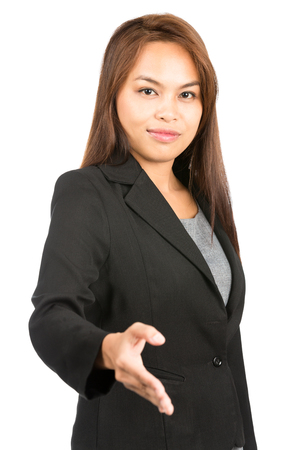 extending: Profile of friendly, warm Asian businesswoman in black business suit grinning, extending hand offering handshake making agreement looking at camera. Thai national of Chinese origin. Vertical half