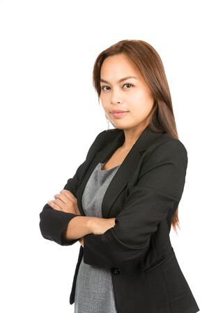 expressionless: Profile of confident, no-nonsense Asian career professional in black business jacket, dress looking at camera showing strong, leadership, competent attitude. Thai national of Chinese origin. Half