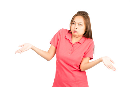 clueless: Unsure and indifferent Asian woman dressed in casual clothes, frowning, throwing hands up, shrugging shoulders with attitude of uncertainty, indecision, apathy, or who cares Stock Photo