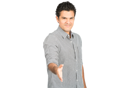 dress shirt: Friendly, good looking hispanic man in casual dress shirt extending, offering handshake looking directly at camera, greeting warmly with a caring smile. Horizontal half-length