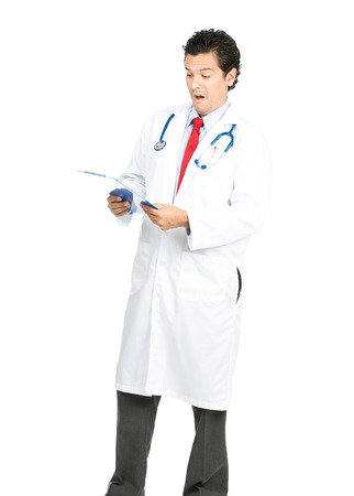 An empathetic hispanic male doctor expresses surprised, shocked, disbelief on seeing the diagnosis and results on medical tests. Vertical Full