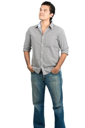personas de pie: Un hombre hispano curiosa en ropa casual atrapados en la atención mirando mirando copia espacio vacío o área de colocación de productos mostrando asombro, interés o pensamiento pensativo