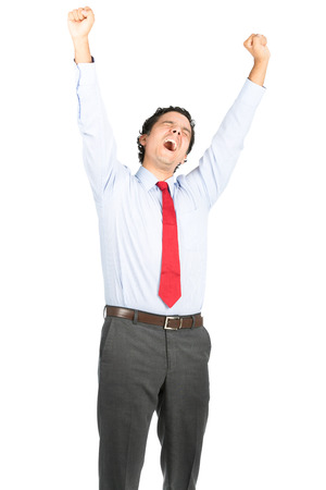 weary: A tired hispanic male office worker in business clothes raising arms up high stretching, tilting head back yawning showing weary attitude to hard days work