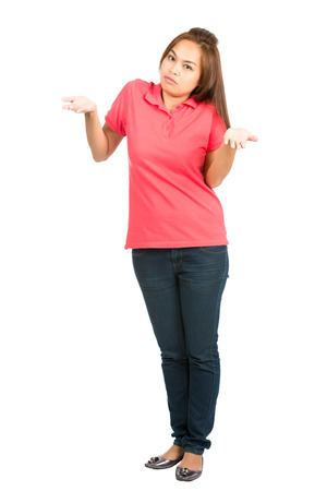 i don't know: A full length portrait of a cute Asian woman shrugging her shoulders and palms up implying unsure, uncertain, apathetic or I dont know attitude while looking at camera. Vertical