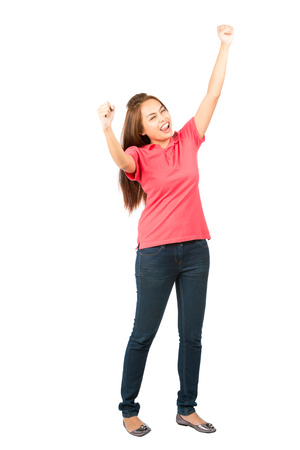 white achievement: Isolated on white background full length profile of a beautiful Asian woman wearing casual clothes, eyes closed, fists and arms raised in the air celebrating victorious win or successful achievement Stock Photo