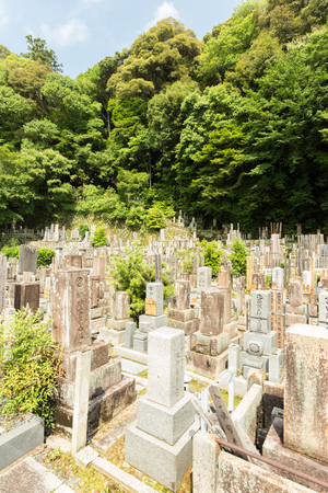 deceased: Ancient engraved headstones of the deceased at a Buddhist cemetery upstairs and behind Chion-In temple in historic Kyoto, Japan. Vertical