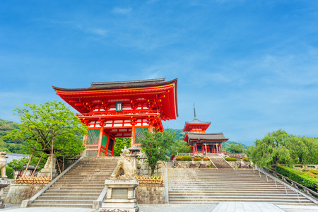 main gate: Beautiful clear blue sky behind Ro-Mon and Triple Pagoda at the stairs entrance to Kiyomizudera Temple in the evening with no people present in Kyoto, Japan. Horizontal copy space Stock Photo