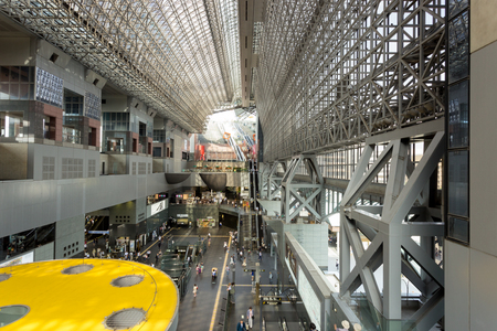 atrium: KYOTO, JAPAN - JUNE 10, 2015: Mezzanine view of the length of the atrium at Kyoto Station, an architectural wonder and tourist attraction in Japan