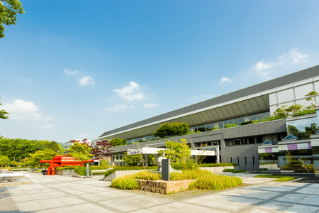 messe: KYOTO, JAPAN - JUNE 12, 2015: Front facade of Miyako Messe, a convention center and international exhibition hall housing the Museum of Traditional Crafts on a sunny day