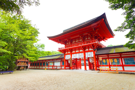 main gate: No people present at the main gate to Shimogamo shrine and entrance door, one of the oldest shinto shrines in Kyoto, Japan, formally known as Kamo Mioya Jinja. Horizontal Editorial