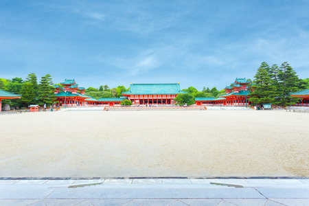 centered: Wide inner courtyard with main Taikyokuden building centered of the Heian-Jingu shinto shrine on a clear, sunny, blue sky day in Kyoto, Japan Editorial