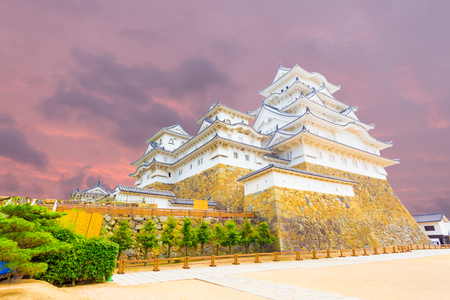 renovated: Wide yard below at the base of Himeji-jo castle on a colorful sunset evening in Himeji, Japan after newly renovated early 2015. Angled horizontal copy space Editorial