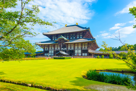 todaiji: Wide green lawn in front entrance facade on grounds of main Great Buddha Hall, Daibutsuden, on a beautiful, blue sky summer morning at Todai-ji temple in Nara, Japan. Horizontal