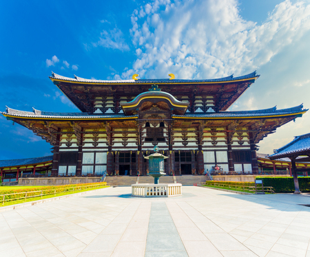 todaiji: Wide path leading to front exterior facade of Great Buddha Hall, Daibutsuden on sunny, blue sky day in Todai-ji temple empty of people in Nara, Japan. Horizontal Editorial