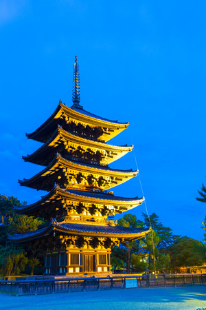 storied: Beautiful blue sky and lighted five story pagoda, goju-no-to, at evening blue hour in Kofuku-ji temple complex in Nara, Japan Stock Photo