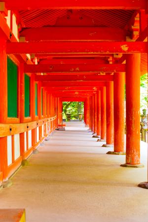 todaiji: Repeating red columns of an outdoor hallway around outside of Kasuga-Taisha Shinto shrine at Todai-ji temple complex in Nara, Japan