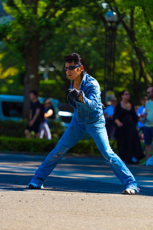 slicked: TOKYO, JAPAN - JUNE 26, 2016: Rockabilly dancing male in vintage full jean outfit and slicked back hair performs to rock and roll music weekly at Yoyogi park Editorial