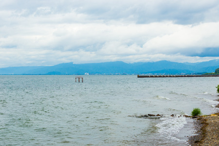 Cloudy, stormy weather above Lake Biwa along the shores of Hikone, Japan. Horizontal