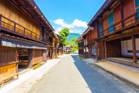 gifu: Beautiful wood structures line the sides of the main street of Tsumago on the Tsumago-Magome portion of Nakasendo route in Gifu, Japan. Horizontal