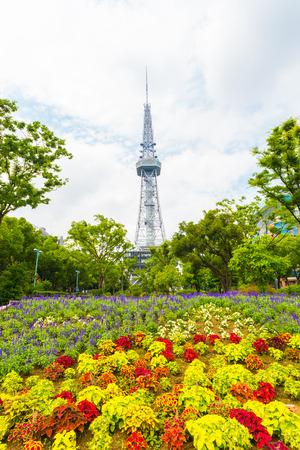 odori: Nagoya TV Tower in background of a colorful flower garden at Hisaya Odori Park in central Nagoya, Japan Stock Photo